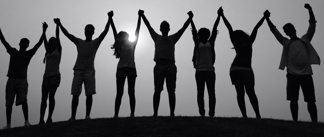 A group of people with their hands in the air - Small Talk Big Difference