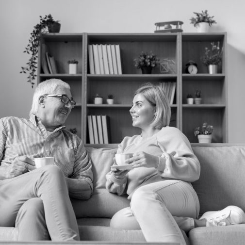 Man and woman sitting on the couch having a cup of tea - Small Talk Big Difference